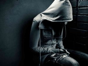 Depressed person wearing a hoodie